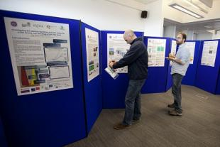 The lunchtime poster session proves popular with the assembly attendees.
